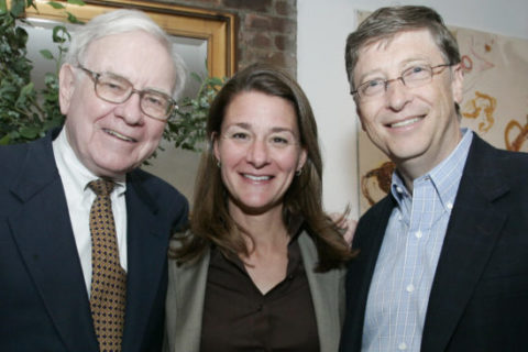Warren Buffett, left, Melinda French Gates and Bill Gates stand together, Sunday, June 25, 2006, in New York, shortly after Warren Buffett's historic announcement.